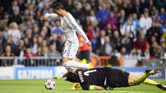 Cristiano Ronaldo rounds Gianluigi Buffon to give Real Madrid the lead against Juventus after four minutes.