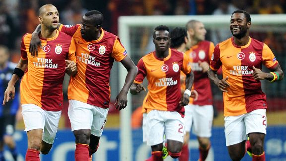 Galatasaray celebrate after Felipe Melo (l) gave them the lead.