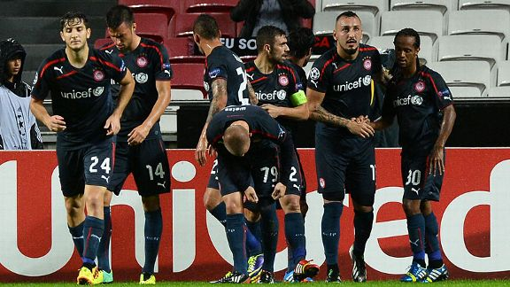 Joy for Olympiakos after Alejandro Dominguez fired them in front at Benfica.
