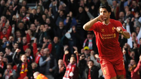 Luis Suarez celebrates his second goal against West Brom.