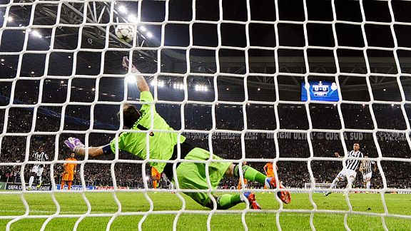 Iker Casillas is powerless to keep out Arturo Vidal's penalty kick.