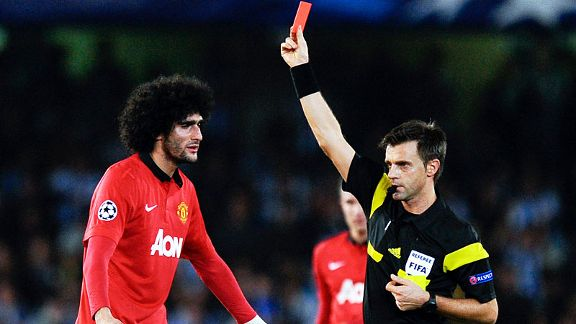 Marouane Fellaini receives his marching orders at Sociedad from referee Nicola Rizzoli.