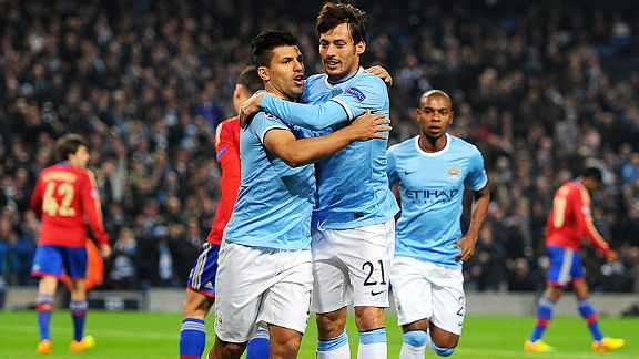 Goalscorer Sergio Aguero celebrates with David Silva, who won the penalty, after Man City took the lead against CSKA.