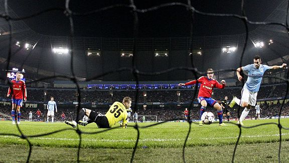 Alvaro Negredo scores Man City's second in their home win over CSKA as they qualified for the knockout rounds.