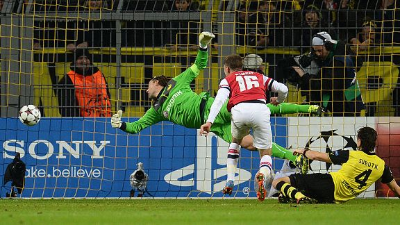 Aaron Ramsey stoops to head Arsenal into the lead against Borussia Dortmund.