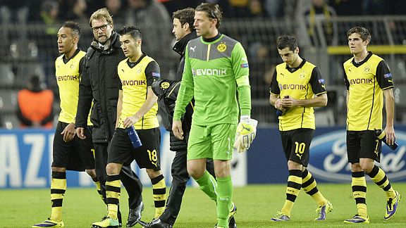 Borussia Dortmund's stars and coach Juergen Klopp are downtrodden at the final whistle after losing to Arsenal.