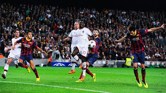 Sergio Busquets heads home Barcelona's second goal against AC Milan