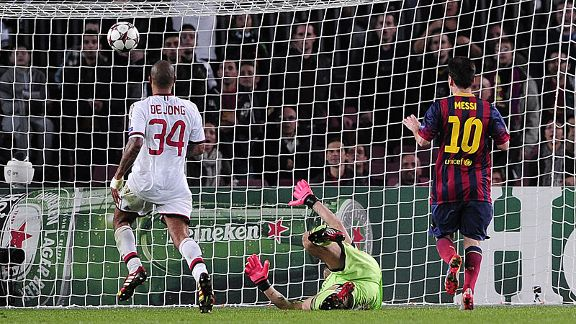 Lionel Messi scores his second, and Barcelona's third, in the 3-1 win at home to AC Milan.
