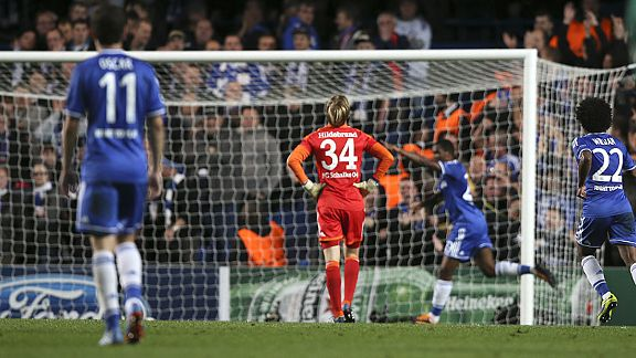 Schalke goalkeeper Timo Hildebrand can only stand and watch after his hesitation gifted Samuel Eto'o a goal.