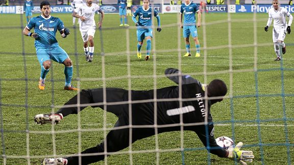 Helton gets down well to save Hulk's penalty