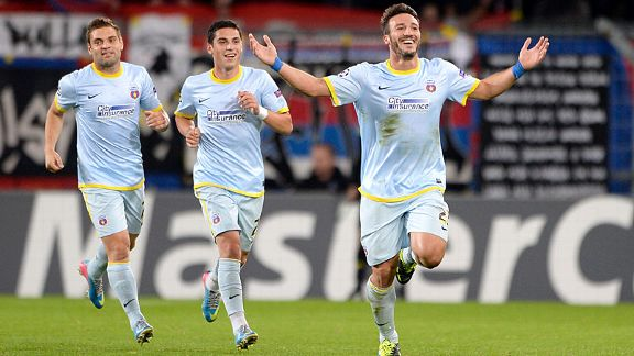 Steaua celebrate Federico Piovaccari's goal at Basel.
