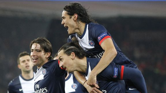 Zlatan Ibrahimovic is congratulated by Edinson Cavani after scoring for PSG against Olympiakos.