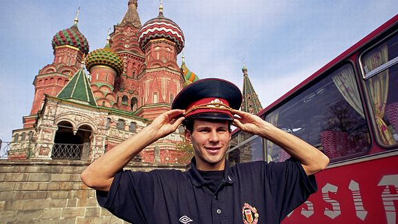 Manchester United's Ryan Giggs poses in front of St Basil's Cathedral in Red Square ahead of a UEFA Cup tie against Torpedo Moscow.