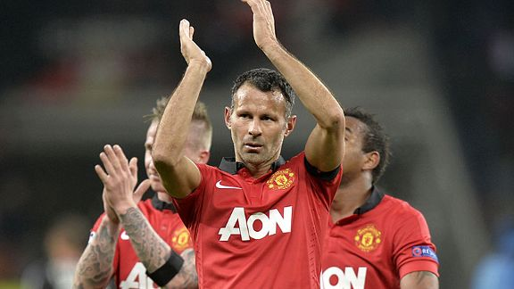 Ryan Giggs applauds the United fans after putting in a superb performance in the 5-0 Champions League thrashing of Leverkusen in Germany just two days before his 40th birthday.