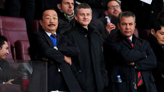 Manager in waiting Ole Gunnar Solskjaer watches on from stands with Cardiff owner Vincent Tan.