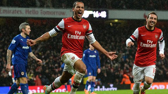 Theo Walcott celebrates after doubling Arsenal's lead against Cardiff.