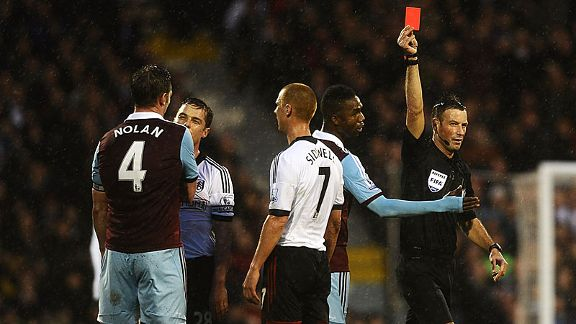 Mark Clattenburg shows Kevin Nolan his second red card in a matter of weeks.