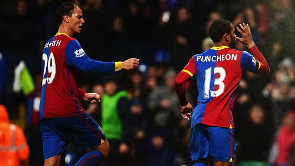 Marouane Chamakh celebrates with goalscorer Jason Puncheon after Palace drew level with Norwich.
