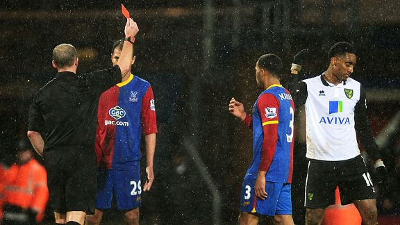 Norwich's Leroy Fer is dismissed after picking up a second yellow card at Palace.
