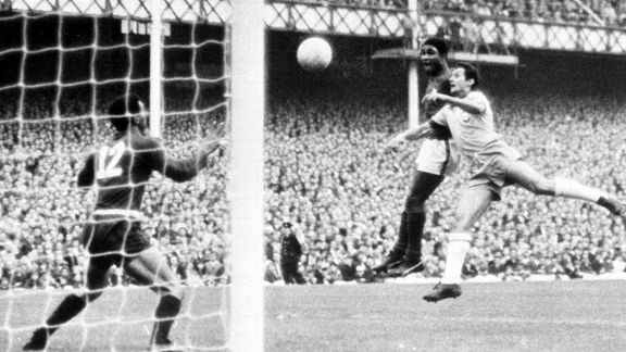 Eusebio out jumps his marker to score against Brazil in 1966