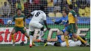 Harry Kewell uses his arm to prevent Jonathan Mensah's shot from hitting the back of the net