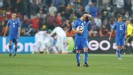 Italy's Antonio Di Natale (centre) stands dejected after conceding their second goal as Slovakia players celebrate