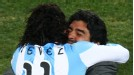 Diego Maradona hugs Carlos Tevez after his long-range strike put Argentina 3-0 ahead