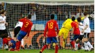 Carles Puyol heads the ball past Manuel Neuer
