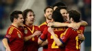 Cesc Fabregas celebrates with his team-mates after putting Spain 1-0 up against Uruguay