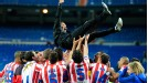 Coach Diego Simeone is lifted as Atletico celebrate their Copa del Rey win