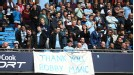 Man City fans display a banner in support of their sacked manager, Roberto Mancini