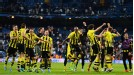 Borussia Dortmund celebrate after holding on against Real Madrid's late onslaught to make the Champions League final