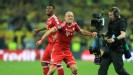 Arjen Robben celebrates after his late goal secured victory for Bayern