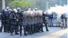 Riot police clash with protestors outside of Maracana stadium