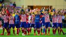 Atletico Madrid celebrate at the final whistle after knocking Barcelona out of the Champions League.