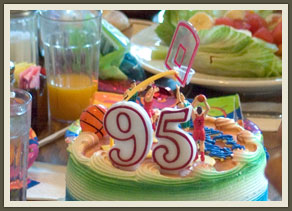 It was a raucous gathering, everything but the number on the cake suggested a child's birthday party.