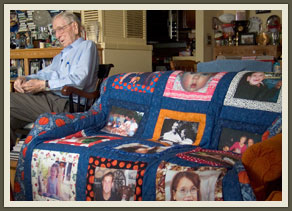 This quilt, made by one of his granddaughters and incorporating photos of many of his 13 great-grandchildren, is one of many symbols of his deep connection and love of family.