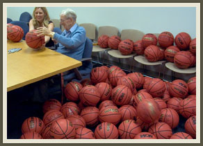 Even at 95, Wooden is tireless. His signature on the last of 300 basketballs was as clear as the first.