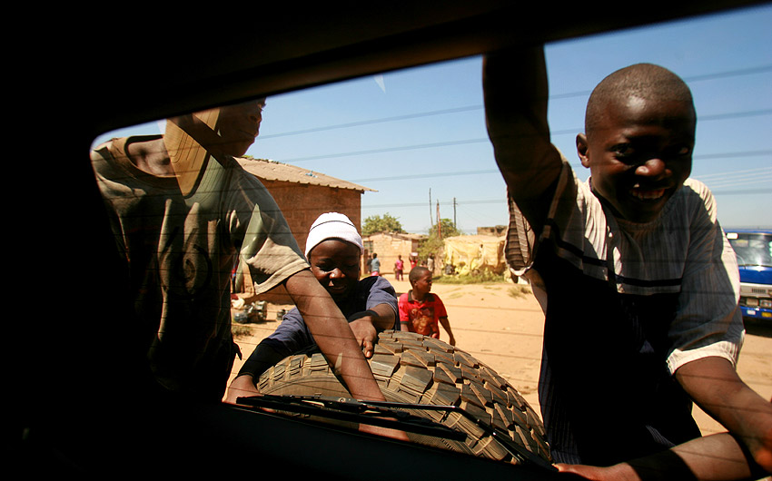 Zambian children chase the champ