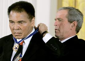 Muhammad Ali (L) and George W. Bush