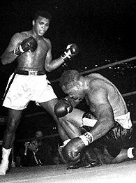 Muhammad Ali/Archie Moore (kneeling)