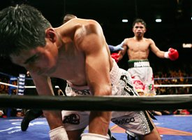 Erik Morales (foreground)/Manny Pacquiao