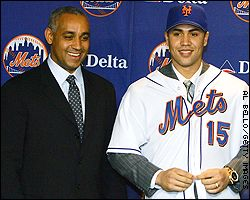 Carlos Beltran (R) and Omar Minaya
