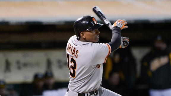 Arias powers Giants to victory against Padres