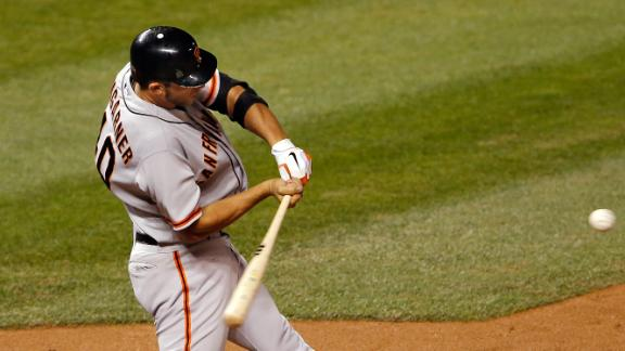 Bumgarner's blast helps Giants hold off Rockies