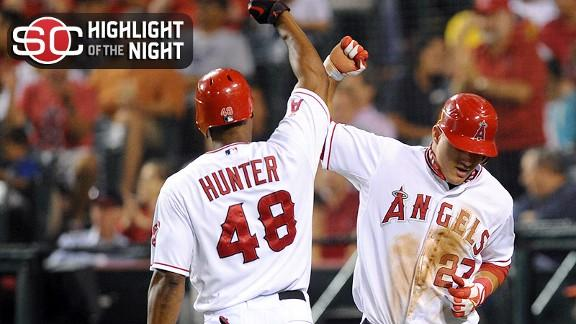 Angels boost playoff hopes with rout of Rangers