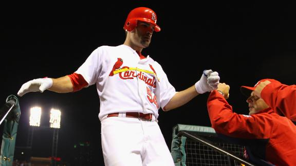 Cards stop Reds to clinch tie for 2nd wild card
