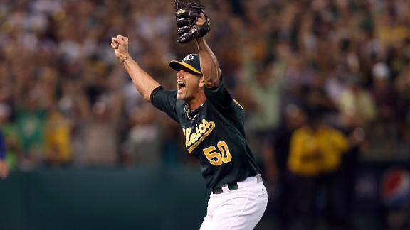 A's clinch playoff spot, inch closer to Rangers