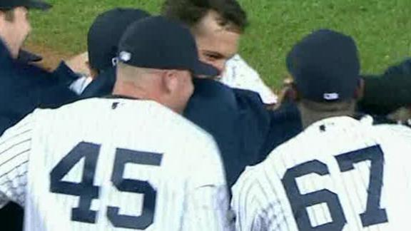 Yanks win in 12, maintain one-game East lead