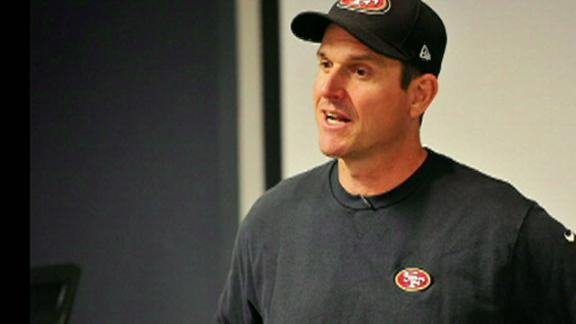 Harbaugh returns to Niners after heart procedure